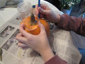Trace the rim of the cup on your pumpkin so yo know how much to carve (the cup will hold your flowers).