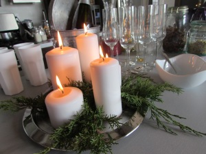Simple candle and greenery centre piece.